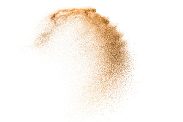 Gold sand explosion isolated on white background. Abstract sand cloud. Gold sand splash agianst on clear background. Sandy fly wave in the air. Wall mural