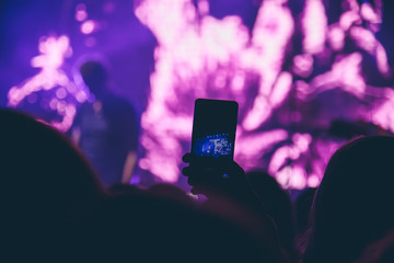 Woman takes pictures at a concert