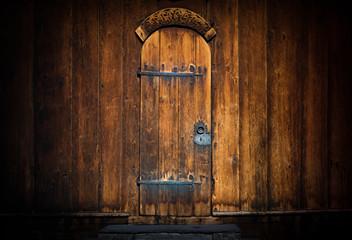 Old wooden door of church, Europe