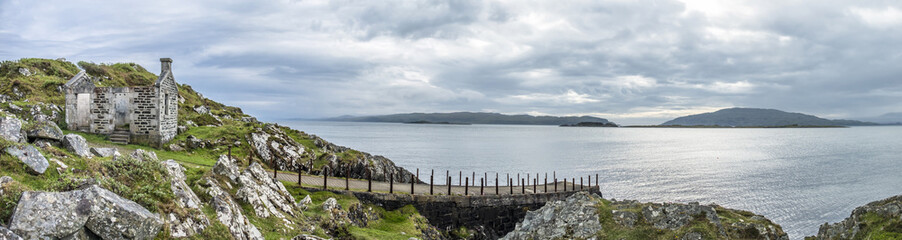 The rooten pier at craignish point with the Sound of Jura in the background