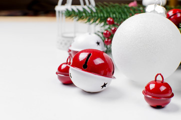 christmas background with fir, red and white  balls, bellsl and winter berries