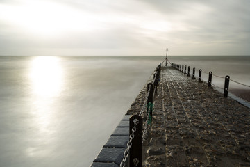 Atmospheric and Moody Long Exposure Photograph of Stone Pier at Brighton, East Sussex, England, UK with copy space