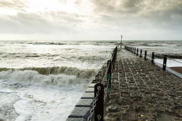 Atmospheric and Moody Photograph of Stone Pier at Brighton, East Sussex, England, UK