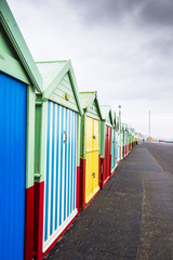 Colourful Beach Huts on Dull, Drab, Cloudy Winters Day in Brighton, West Sussex, England, UK