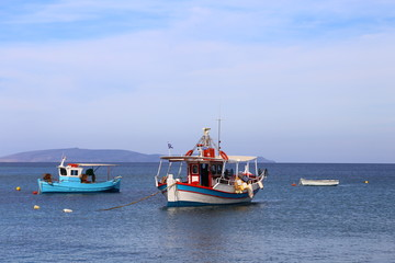 fishing boats on the sea with a blue sky in the background on the cry