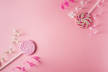 Valentines and birthday card with lollipop or candy on pink background