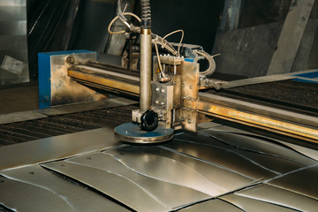 Plasma cut machine cutting steel sheet. Lasercutting  of industrial iron works