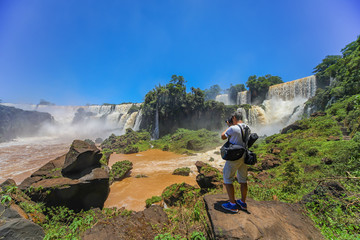 Man photographed at the Iguazu Falls on the argentine side.