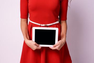 Modern tablet. Hands girl. White background