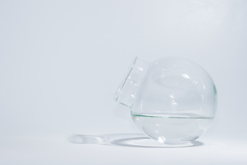 Globular jar filled with water inside White background