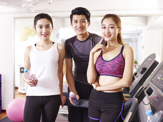 portrait of three young asian young adult in gym