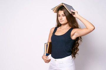 Serious girl. Young student. Stern look. Books