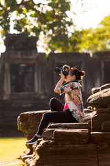 woman tourist taking a photography by dslr camera at traveling location