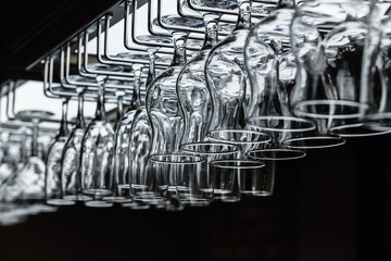 Wineglasses and goblets on a black background.