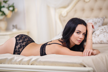 Beautiful brunette woman in a sexy black lingerie