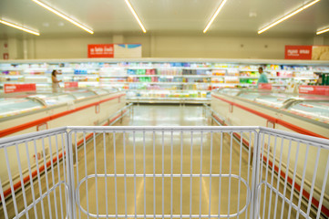 Shopping Trolley Cart with in Hypermarket or Supermarket at Dairy Product Section