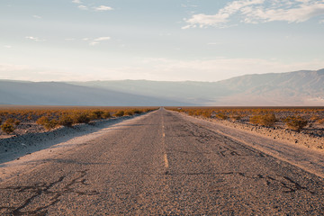 Old infinite road to the horizon. Route 66. Road through the death valley.