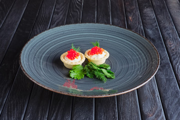 Tartlet with caviar, soft cheese. Appetizer for reception