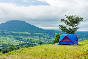 Blue fabric tent on mountain at Khao Ta-Khian Ngo Viewpoint. The location in Khao Kho District, Phetchabun, Thailand, Southeast Asia.