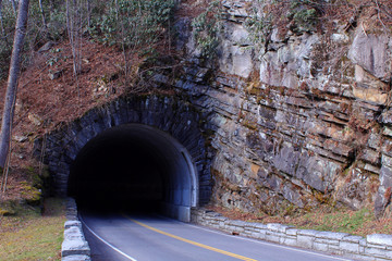 Stone Man Made Tunnel and Street Photography of a Road Through a Mountain.