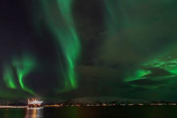 Amazing Aurora Borealis in North Norway above the sea, Tromso City