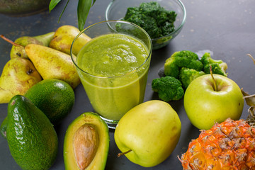 Close up of fresh fruits and vegetables smoothie