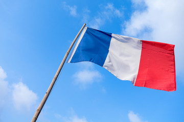 France flag of wave with bamboo flag pole and blue sky background