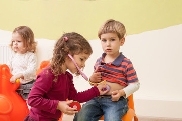 Children playing doctor and patient