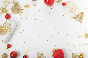 Christmas holiday composition. Festive creative golden pattern, xmas gold decor holiday ball with ribbon, snowflakes, christmas tree on white background.