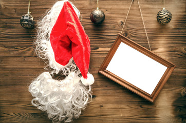 Christmas or new year concept background with copy space. Empty blank photo frame on wooden background.