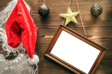 Christmas or new year concept background with copy space. Christmas empty photo frame on wooden background.