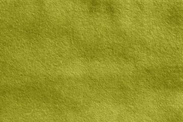Yellow color felt surface.