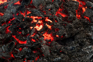 Lava flame on black ash background