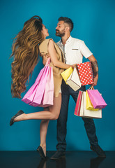 Girl and bearded man hold present pack, cyber Monday.