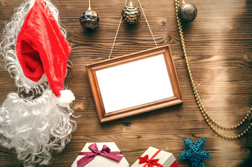 Christmas or new year concept background with copy space. Christmas empty photo frame and gift present boxes on wooden background.