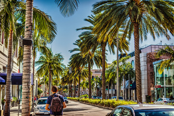 Tourist in Rodeo Drive on a sunny day