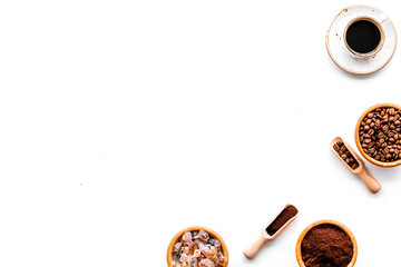 Coffee concept. Roasted beans, ground coffee, cup of espresso and sugar on white background top view copyspace