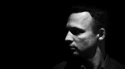 Closeup studio profile portrait of young man