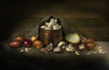 Still life with mushrooms,onions and potatoes