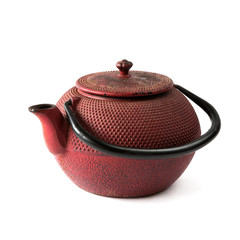 Old antique cast iron teapot on white background isolated close-up