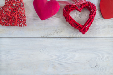 various red hearts on white rustic background