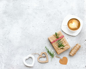 Flat lay composition with cup of coffee, gift box and decorations