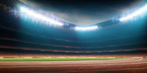 night stadium with running track and soccer field