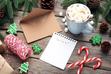 Blank sheet of paper with fir-tree branches and cup of coffee