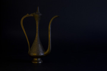ancient bronze oil container