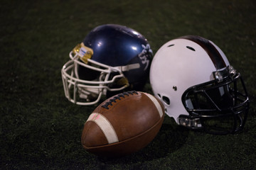 american football and helmets