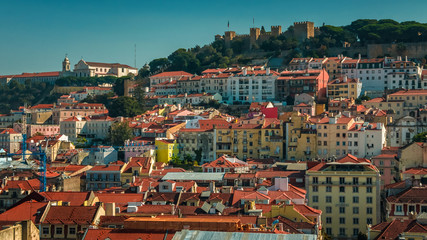 Daytime wide shot of the Sao Jorge Castle - Castelo de Sao Jorge - in Lisbon, Portugal. The Saint George Castle is a Moorish castle commanding hilltop views.