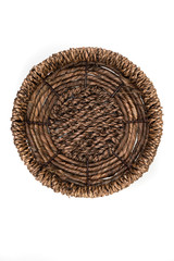 Brown straw basket on a white background