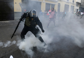 Protesters clash with police during a march after Peruvian President Pedro Pablo Kuczynski pardoned former President Alberto Fujimori in Lima