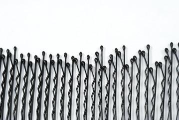 black hair pin on white background
